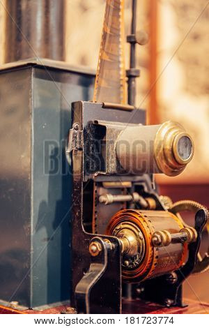 Ancient vintage film projector with cine-film, vertical photo