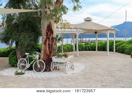Vintage bicycle and horse cart with flowers with sea view