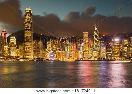 Night blurred bokeh light Hong Kong city downtown abstract background