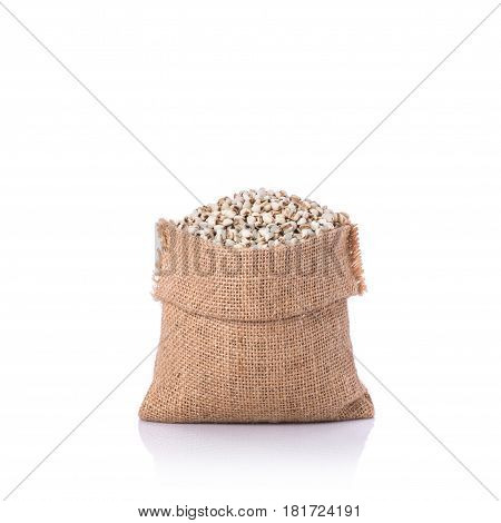 Millet Rice Or Millet Grains In Small Sack. Studio Shot Isolated On White Background