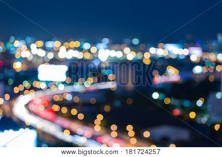 Blue twilight sky background city road curved and downtown cityscape night view