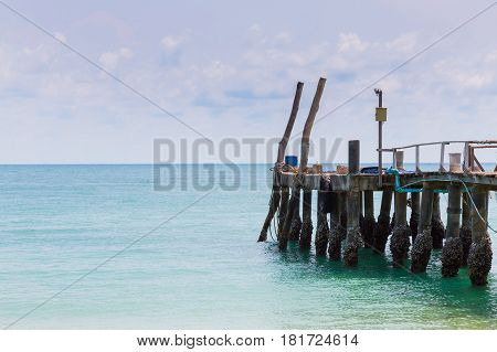 Fishing jetty leading to ocean skyline nautral landscape background