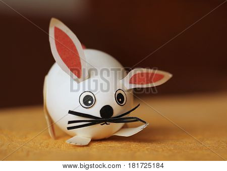 funny easter egg decorated like a cute white rabbit with long ears