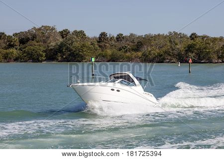 Motorbaot in the Gulf of Mexico. Mangrove forest in the background. Naples Florida United States