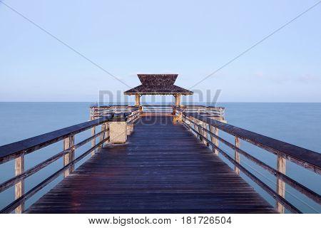 Fishing pier in Naples illuminated at dusk. Florida United States