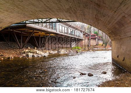 Chattahoochee river arch of bridge over it and buildings on its shore Helen USA