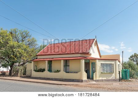 WILLOWMORE SOUTH AFRICA - MARCH 23 2017: An old house with rain water tank in Willowmore a small town in the Eastern Cape Province
