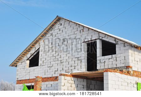 Winter construction. Winter Home Building. Unfinished house.