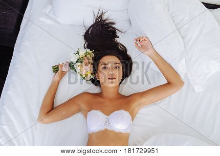 Beautiful Sexy Bride Woman. Wedding Makeup. Curly Hairstyle. Attractive Young Girl Model With Long W