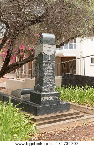 DE RUST SOUTH AFRICA - MARCH 23 2017: A monument for a former minister at the Dutch Reformed Church in De Rust a village in the Western Cape Province of South Africa