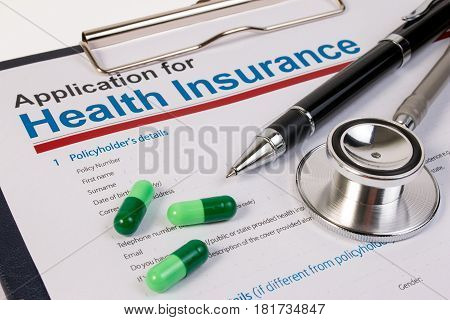 Application Form For Health Insurance, Paperwork, Questionnaire, Pen, Tablet And Stethoscope. Health