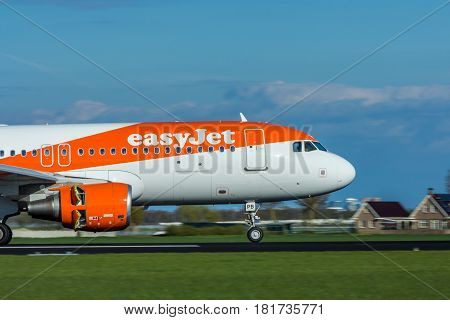 Amsterdam Schiphol Airport the Netherlands - April 14 2017: Easyjet aircraft landing at Amsterdam Schiphol Airport