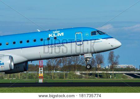 Amsterdam Schiphol Airport the Netherlands - April 14 2017: KLM cityhopper aircraft landing at Amsterdam Schiphol Airport