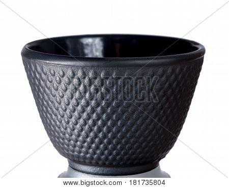 Black traditional teacup of cast iron isolated on white background.