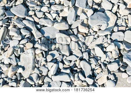 abstract background with round peeble stones in black sea.