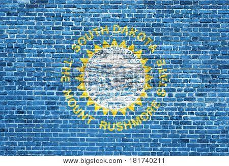 South Dakota US flag painted on old vintage brick wall