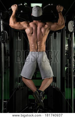 Male Bodybuilding Athlete Doing Pull Ups