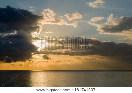 Afternoon winter sun with dramatic cloudy sky over English Channel
