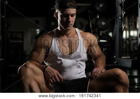 Athlete Relax After Exercise In Gym