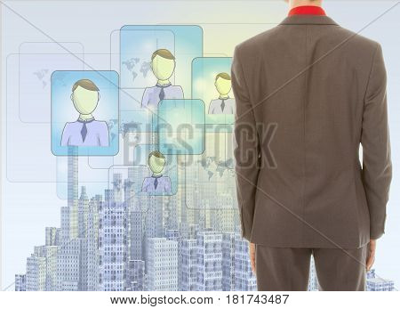 Young businessman with rendered city skyline and people connections