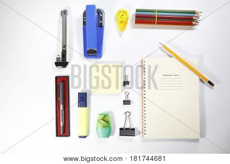 Arrangement of various office items isolated on white background, back to school and office items show off concept