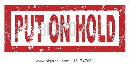 Rubber stamp with the text put on hold over a white background