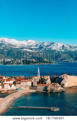 The Old Town of Budva, mountains covered with snow, Montenegro