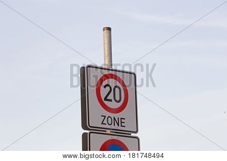 German sign zone of maximum speed 20, blue cloudless sky