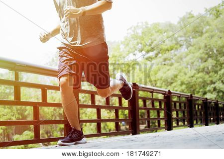 Young Man Doing Sports And Jogging, Runing In A Park.