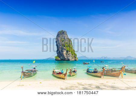 Krabi, THAILAND-February 20,2017: Thailand summer travel sea, Thai old wood boat at sea beach Krabi Phi Phi Island Phuket park on white sand blue sky emerald green ocean water.