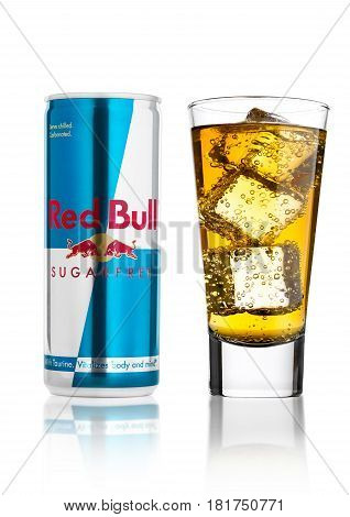 London, Uk - April 12, 2017: Can Of Red Bull Energy Drink Sugar Free With Glass And Ice Cubes On Whi