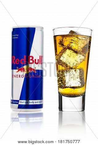London, Uk - April 12, 2017: Can Of Red Bull Energy Drink With Glass And Ice Cubes On White Backgrou