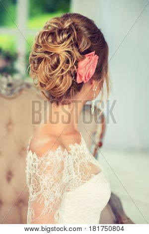 Beautiful model with elegant hairstyle . Beautiful woman with fashion wedding hairstyle with flower roses and colourful makeup