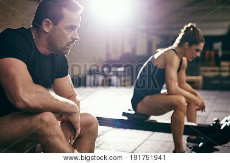 Two Sportsmen Having Rest After Hard Workout