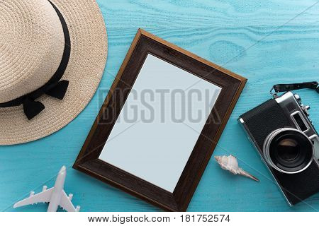 Summer holiday background Travel and vacation items on wooden table. Top view