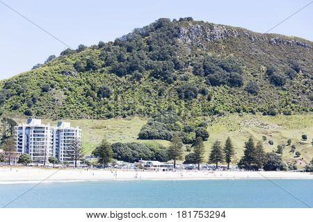 Mount Maunganui resort town beach with the same name mountain behind (New Zealand).