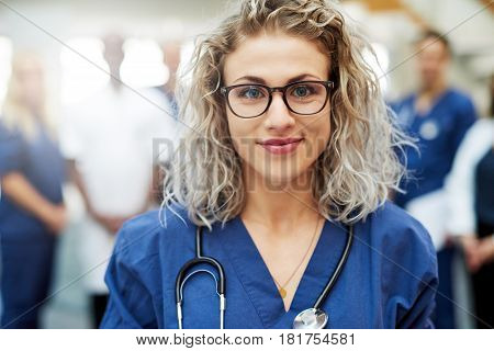 Blonde Female Medic In Hospital Looking At Camera