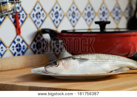Mullet Striped Mullet Contains Omega-3 Acids, Vitamins And Minerals. Mullet Lying On Plate Ready For