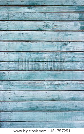 Background blue old peeling boards are arranged vertically