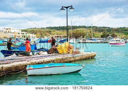 Fishermen On Luzzu Boat At Marsaxlokk Harbor Malta