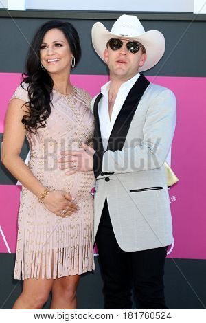 LAS VEGAS - APR 2:  Kate Moore, Justin Moore at the Academy of Country Music Awards 2017 at T-Mobile Arena on April 2, 2017 in Las Vegas, NV