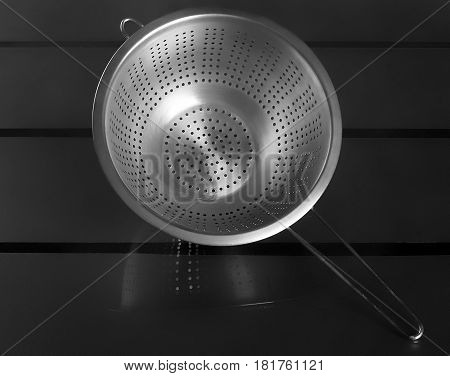 Empty sieve strainer stainless metal with handle Top view