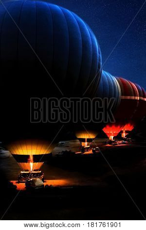 Balloons at the start at dawn. Turkey, Cappadocia, Goreme.