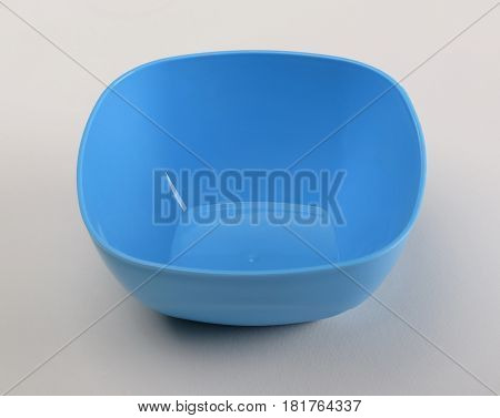 Blue plastic deep dish isolated on white background