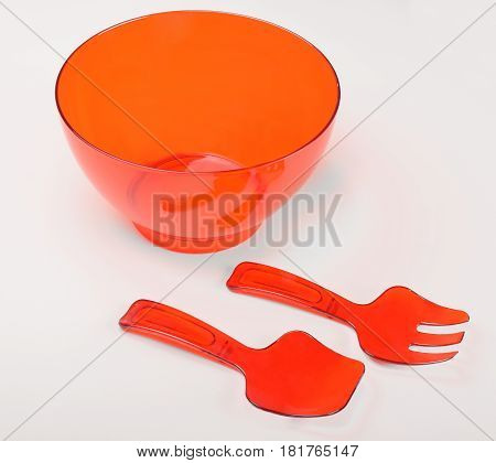 Red plastic container for stirring cake isolated on whte background
