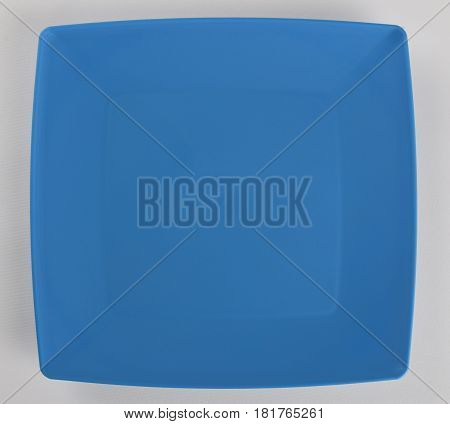 Blue plastic shallow dish food top view