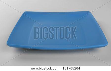 Blue plastic shallow dish food isolated on white background