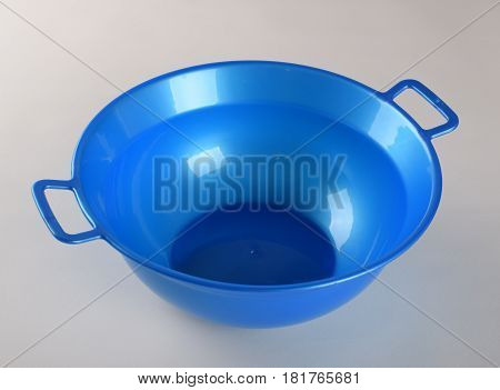 Blue deep plastic bowl with handles isolated on white background