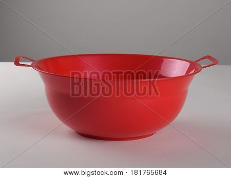 Red deep plastic bowl with two handles