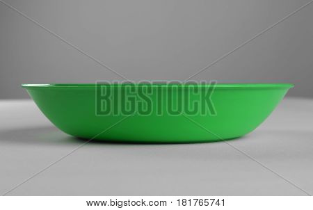 Green plastic shallow dish food on the table